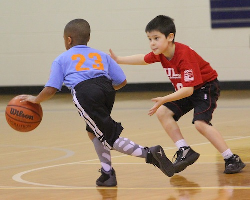 Two boys playing youth basketball